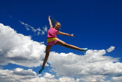 Acrobatic girl in midair Stock Photos