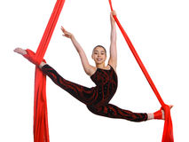 Acrobatic gymnastic girl exercising on fabric rope Stock Image