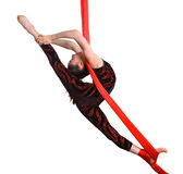 Acrobatic gymnastic girl exercising on red rope Royalty Free Stock Images