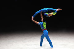 Acrobatic gymnastics. Image of the two acrobats is benefis Jordan Jovtchev the gymnast participate in 6 Olympics Royalty Free Stock Photo