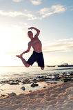 high jumping on beach Royalty Free Stock Images