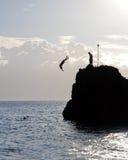 Acrobatic jumper. A jumper in Maui, Hawaii (Black rock Royalty Free Stock Photos