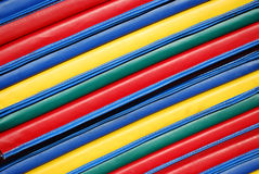 Acrobatic Mats. Colorful acrobatic mats stacked and photographed at an angle Stock Photos
