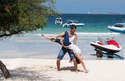 Acrobatic at ocean Royalty Free Stock Photo