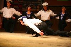 Acrobatic old traditional national Russian sailor dance Yablochko Stock Photography