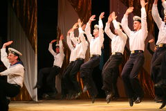 Acrobatic old traditional national Russian sailor dance Yablochko Royalty Free Stock Images