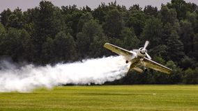Jurgis Kairis on Su-31 during display in Goraszka in Poland. Acrobatic pilot perform low pass in Goraszka air sho in 2007 in Poland. There is a white contrail Stock Photo