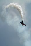 Acrobatic plane. A plane doing acrobatic figures in the sky Royalty Free Stock Image
