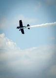 Acrobatic plane in action during airshow Royalty Free Stock Image