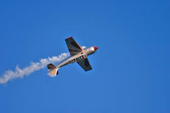 Acrobatic plane during airshow. An acrobatic airplane, model Yakovlev Yak-52, during an airshow in Sicily Royalty Free Stock Photography