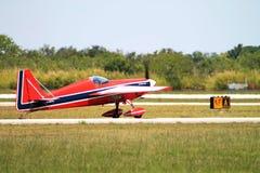 Acrobatic plane taxiing Stock Photos