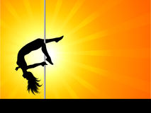 Acrobatic pole dancer. Silhouette of an acrobatic pole dancer Royalty Free Stock Photos