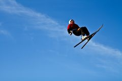 Acrobatic skiing. Acrobatic skier doing a backflip of a big air Royalty Free Stock Image