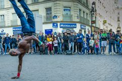 Acrobatic street performer in Paris attracts a crowd royalty free stock photos
