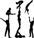 Acrobatic stunt. Gymnasts acrobats vector black silhouette. Gymnasts acrobats vector Royalty Free Stock Photo