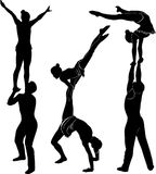 Acrobatic stunt. Gymnasts acrobats vector black silhouette.  Stock Image