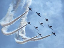 Aerobatic team. Red arrows over polish sky Royalty Free Stock Photo