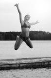 Acrobatic water jump Royalty Free Stock Image