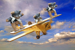 Acrobatic wingwalking teddy bears. Photo of a WW1 acrobatic wingwalking teddy bears performing stunts on wings of plane Stock Photo