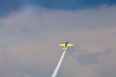Acrobatic YAK-52 plane at BIAS 2015. Bucharest International Air Show 2015 (BIAS 2015). In action a YAK-52 plane in the sky Royalty Free Stock Photography