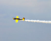 Acrobatic YAK-52 plane at BIAS 2015. Bucharest International Air Show 2015 (BIAS 2015). In action a YAK-52 plane in the sky Stock Photo