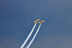 Acrobatic YAK-52 planes at BIAS 2015. Bucharest International Air Show 2015 (BIAS 2015). In action 2 planes YAK-52 in the sky Royalty Free Stock Images