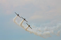Acrobatic YAK-52 planes at BIAS 2015. Bucharest International Air Show 2015 (BIAS 2015). In action 3 planes YAK-52 in the sky Royalty Free Stock Image