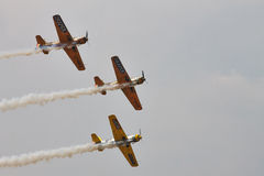 Acrobatic YAK-52 planes at BIAS 2015. Bucharest International Air Show 2015 (BIAS 2015). In action 3 planes YAK-52 in the sky Stock Image