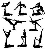 Acrobatic yoga silhouettes. Silhouettes of man and woman doing acrobatic yoga Stock Photo