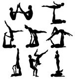 Acrobatic yoga silhouettes Royalty Free Stock Photos