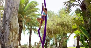 Acrobatic young woman doing an exotic dance stock video footage