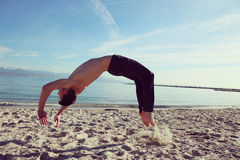 Acrobatics on the beach Stock Photography