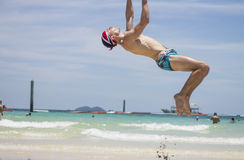 Acrobatics on the beach Stock Photos