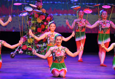 Acrobatics-Bowls. In September 23, 2013, the Jiangxi acrobatic troupe to perform acrobatics party our life is sweeter than honey staged in Jiangxi province stock photography