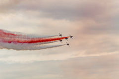 Acrobatics. A group of fighter performed aerobatic flight Stock Photos