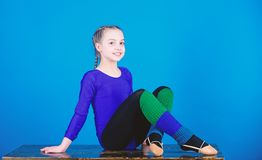 Acrobatics gym workout of girl. Gymnastics. Happy child sportsman. Fitness diet. Energy. success. Childhood activity. Sport and health. Having a little break royalty free stock images