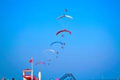 Acrobatics parachute. People tumbling air parachute synchronous royalty free stock photos