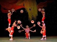 Acrobatics throwing the hat Stock Photo