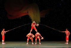 Acrobatics throwing the hat Stock Photos