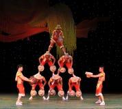 Acrobatics throwing the hat Royalty Free Stock Photos