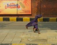 Acrobatiek voor geld Stock Foto's