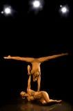 Acrobatisch meisje twee stock afbeeldingen