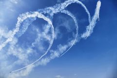 Acrobatric airplanes on blue cloudy sky during airshow. Turin Italy circa June 2016 royalty free stock photography