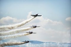 Acrobatric airplanes on blue cloudy sky during airshow. Turin Italy circa June 2016 stock photo