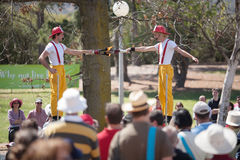 Acrobats and flame jugglers busking Royalty Free Stock Image