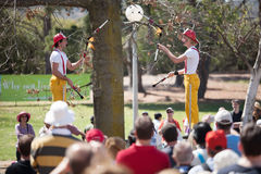 Acrobats and flame jugglers busking Royalty Free Stock Photo