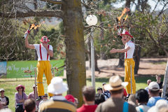 Acrobats and flame jugglers busking Stock Photo