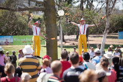 Acrobats and flame jugglers busking Royalty Free Stock Photography