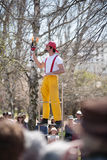 Acrobats and flame jugglers busking Royalty Free Stock Photos