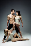Acrobats man and two women Stock Image